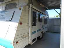 URGENT Sale 2002 17.6ft Jayco Freedom Poptop with awning. F/kitch, a/c, twin beds, 3way fridge, gas elect stove, 2dr annex, heaps of extras, sml w/machine, very good cond.  Phone 54986012 Caboolture