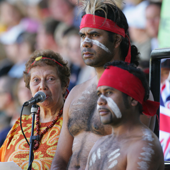 Gubbi Gubbi elder Eve Fesl, with her sons, speaks at the Steve Irwin public memorial at Australia Zoo last year.