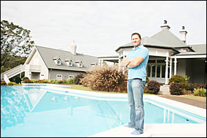 Andrew More stands beside the pool at 'Bandongrove'  a magnificent estate at Possum Creek which has just won a prestigious int