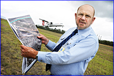 Gladstone Regional Mayor George Creed goes over the airport plans.