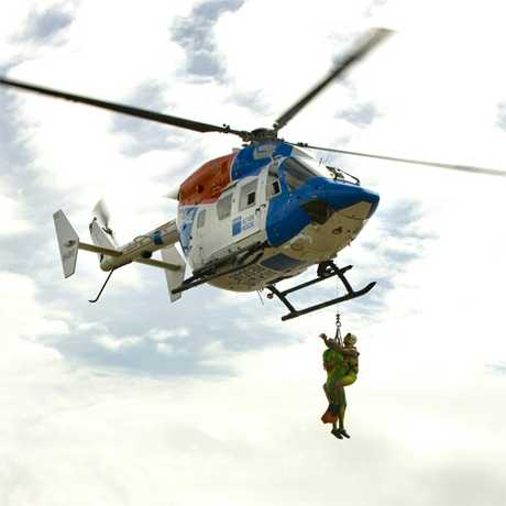 Action Stations: The AGL Action Rescue helicopter makes a demonstration rescue in its new livery. Photo: Phill Jackson