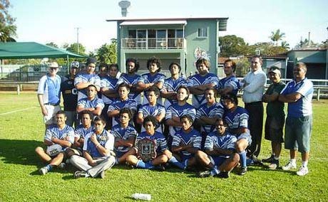 The premiership-winning Woodridge State High School open rugby league team pose for a shot following their historic 22-20 victory over Morayfield in the grand final last Wednesday.