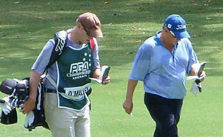 Brian Nilsson, of Gympie, is a professional golf caddy. Nilsson (above left) walks with Peter O'Malley at the Australian PGA at Coolum.