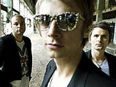 British band Muse (from left) Christopher Wolstenholme, Dominic Howard and Matthew Bellamy.