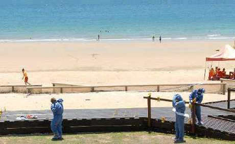 The taped-off viewing platform outside the Mackay Surf Lifesaving Club section at Harbour Beach where Michael Betts, 42, was stabbed to death.