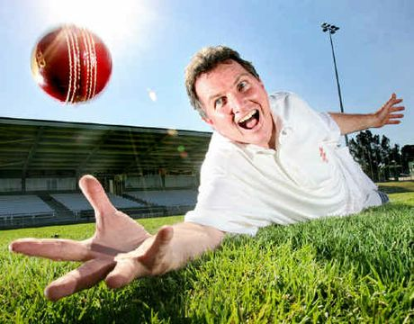 Council parks committee chairman David Morrison dives for a classic catch at the North Ipswich Reserve after they laid a new cricket wicket at the ground.