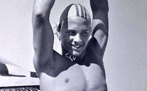 Grant Kenny wins Australian senior and junior ironman titles at Maroochydore Beach, 1980.