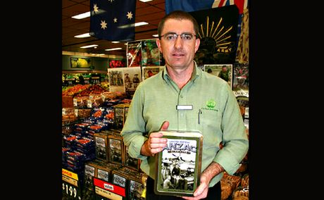 PAYING TRBUTE: Biloela Woolworths manager Ashley Smith, a former soldier who served in East TImor, has set up his own Anzac Day tribute in the supermarket.