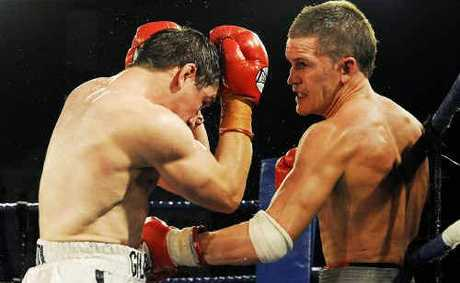 Jason Kanofski (right) produces a brave effort in the Australian welterweight title fight before losing on points to James Giltrow at Brisbanes Hilton Hotel on Saturday night. 