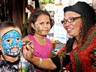 Zander McIvor and Neahlan Namie get their face painted by Suzanne Thompson at the Dreaming Festival.