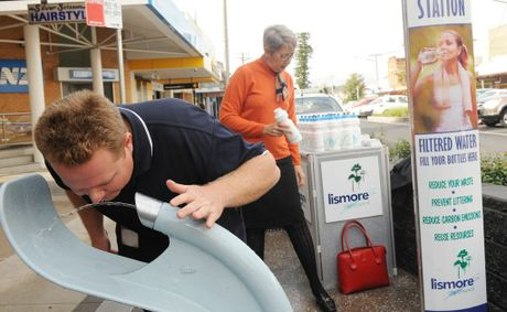 Lismore City Council water education officer Kevin Trustum drinks from one of the new water bubblers on Woodlark Street in the Lismore CBD, while mayor Jenny Dowell lines up refillable water bottles on offer for residents.