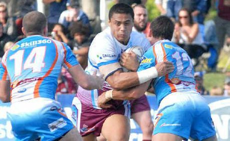 Mackay Cutters prop Isaac Ah Mau charges into the defence of Jason Roos and Mark Cantoni.