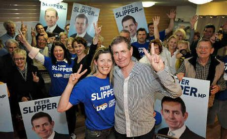 Peter Slipper with his wife Inge by his side, celebrates his re-election to the federal seat of Fisher with his supporters in Caloundra. 