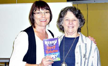 BACK WITH A NEW BOOK: Author Christine Bongers with Marion Meissner, Acting Head of English, who was Bongers&#39; first debating coach, launched Bongers&#39; new book Henry Hoey Hobson at Biloela High School recently.