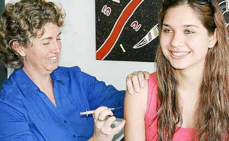 Protected: Public Health nurse Sue Devlin vaccinates Kara Garchevic yesterday.