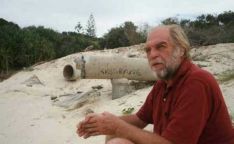 Dr Peter Helman at Broken Head beach, near stormwater pipes which have been eroded by storms and sea level rises.