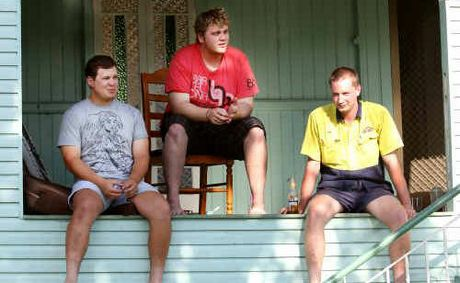 House mates Nathan Kane, Jayme Schneider and Josh Comerford hang out on their deck.