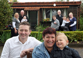 RELAX IN ROTORUA: Canterbury's Sharon Russell (centre front) and her family are enjoying a break in Rotorua, thanks to motelier Jason Edworthy (left) who gave them free accommodation. STEPHEN PARKER 0