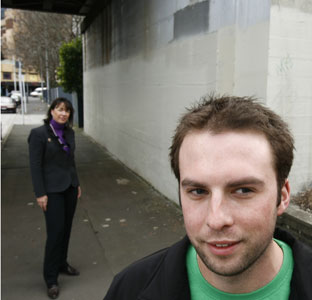 Victoria Carter and James Ure in front of a blank wall where an artwork has been removed. STEVEN MCNICHOLL