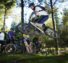 Professional mountainbike rider James Dodds, of Rotorua, shows cross-country skills to riders at Eskdale yesterday.