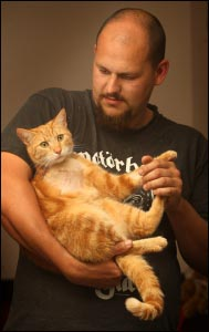 Colin Poultney and his cat TJ. Photo: Alan Gibson