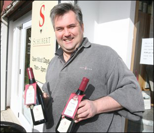 Kai Schubert with bottles of his winning 2008 pinot noir. Photo: Lynda Feringa