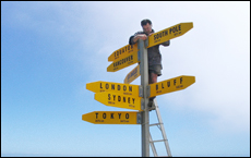 William Macrae replaces pointers on the iconic Cape Reinga signpost. Picture/supplied