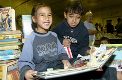 PICTURE: BOB HARDINGBookworms Shae Reti-Maketoni, 6, and brother Taylor, 10, score bargains at Rotary's book sale.