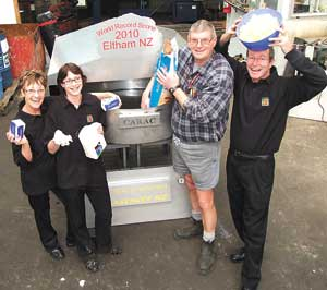 ABOUT to christen the big oven built for the world's biggest scone attempt, are from left, Annette McGregor, Sheena Southey, John Burling and Shaun McCarthy.