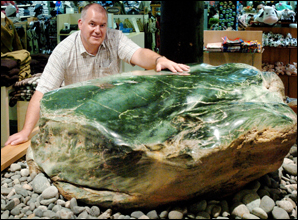 Rob Finlayson with the 1.8 tonne greenstone inside the gift shop at Rainbow Springs. Picture: Kelvin Teixeira (201205kt3)