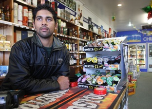 Picture: Joel Ford: Nitin Kumar, 20, duty manager of Cherrywood Liquor, shortly after he was robbed at gunpoint.