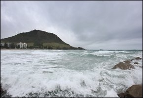WILD: Stormy weather at Mount Maunganui this morning. SAM ACKLAND 130810SA02BOP