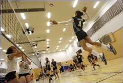 OUTSTANDING: Tauranga captain Taina Savage goes for a spike against Waitakere at Aquinas College. JOEL FORD 120610JF20BOP