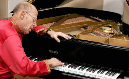 David Helfgott with his new Czechoslovakian grand piano.