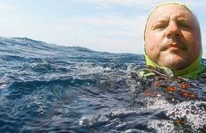 Lost on the ocean floor for nearly four years, a camera containing this image of Peter Trayhurn stranded at sea in December 2006 was discovered on a Wooli beach recently.