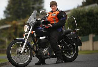Debbie Smith the treasurer of Tauranga Ulysses Motorcycle Club and her 650cc bike. Photo: Sam Ackland.