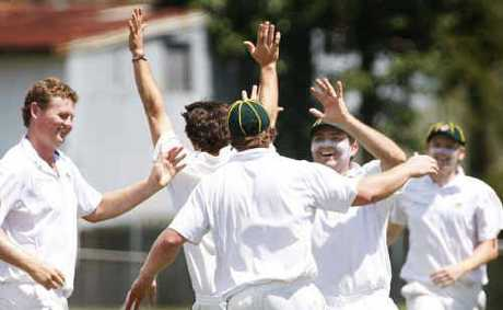 Northsiders bowler Robert Hillier (left) celebrates a wicket with his team mates.