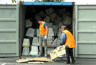 E-Waste: Rob Moore and Kaye Hatfull-Goodwin load a container with Wanganui's e-waste on Saturday.