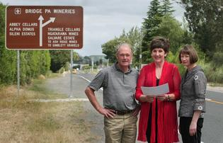 WINE SIGN: Showing visitors the way - Hawke&#39;s Bay Wine Country Tourism chairman Sam Orton, Hastings Deputy Mayor Cynthia Bowers and Bridge Pa wineries group spokeswoman Adrienne Campbell.