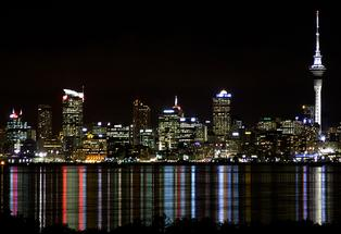 Auckland  city lights up the Hauraki Gulf.