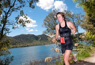 Maddy Brunton on her way to winning the Rotorua round of the Contact Triathlon Series at the Blue Lake.