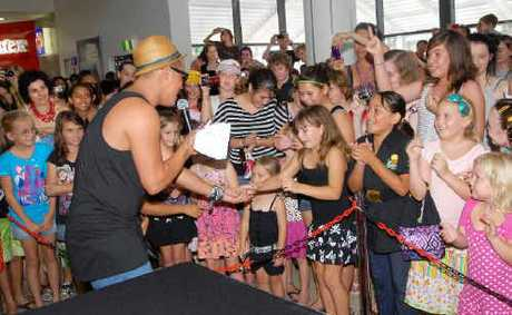 Australian Idol winner Stan Walker performs for some of his younger fans in Mackay yesterday. He was in town to open the new Sanity music store at Mt Pleasant Shopping Centre.