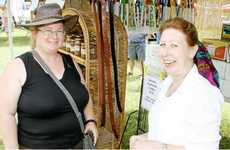 "On holiday from Ontario, Canada, Gwyneth Holtrop got some local gossip from ""Havenwood Creations"" stall holder, Lee Greenslade at the ATC markets."