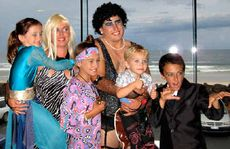 Hazel Edmondson and Rodney Elphick with their children Candice, Chelsey, Cruz and Wade Elphick, at their fancy dress wedding.