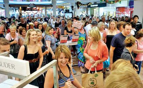 Eager shoppers burst through the doors in search of a Boxing Day bargain at Myer.
