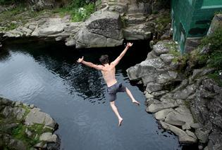 Self-confessed thrillseeker Graham Candy, 19, leaping off the McLaren Falls Bridge.