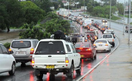 Flood waters caused traffic havoc on the Bruce Highway through Gympie Sunday. This south-bound traffic was backed up from Normanby Hill.