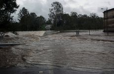 The weir crossing Mt Crosby at about 5pm Monday.