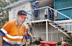 Glen Watson helps with the flood clean-up at Queensborough Parade, Karalee, on Friday.