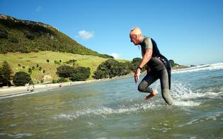 Mount Maunganui identity Sid Salek, 80, completes his 25th Round the Mount swim at Mount Maunganui's Main Beach.